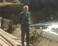 Len England stood on the old weir when the level on the River Mersey was dropped.