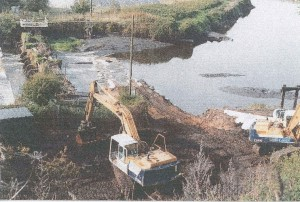 59 removing old weir after